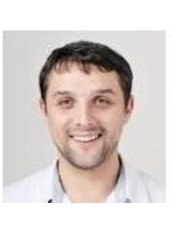 Dr Maxim Voronin - Dentist at Porcelain Group UA - Otto Shmidta