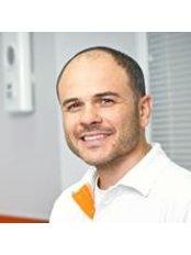 Dr Igor Marisovich Bersutsky - Oral Surgeon at Studio Smile