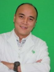 Dr Tran Duc Hao -  at O'Care Dental Clinic