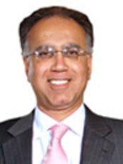 Mr Sunil Godhwani -  at Fortis Healthcare Ltd