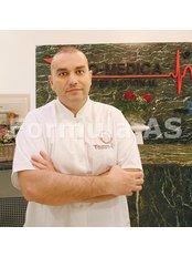 Dr Dan Cristian - Principal Surgeon at Biomedica International SRL