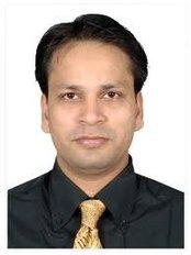 International Prosthetic Eye Center - Dr Kuldeep Raizada, BCO, BADO