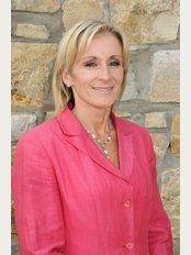Universal Hair, Scalp and Skin Clinic - Dr Carol Johnson