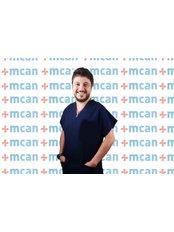 Dr. Tugrul Saygi - Zahnarzt - MCAN Health - Kadıköy