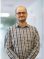 Dr Mateusz Janik - Surgeon at Carolina Medical Center
