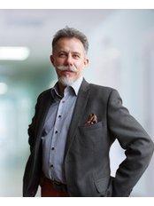 Dr Andrzej Komor - Surgeon at Carolina Medical Center
