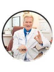 Dr Allan Oolo Austin - Doctor at Trigenics, Physio-Rehab Centre