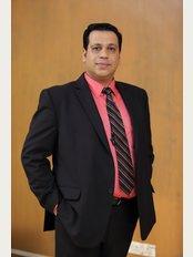 Dr Sanjay Bakhshi's Physioline 'Pain and Paralysis Treatment Center' All over  Mumbai - 1A, Andheri Guruchhaya, Building No-34, Manish Nagar, Four Bungalows, Andheri West, Mumbai, 400053,