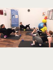 First Class Physiotherapy - Foam rolling class in action!