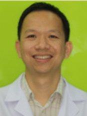 Dental World The Oral Health Center - Dr. Surasak Yowcharoensuk