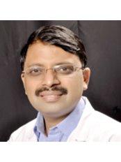 Dr. Vineet Bansal, Dental Implantologist - Dr. Vineet bansal,Dental implantologist