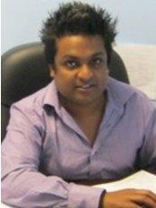 Dr Preeyan Padayachees Dental Clinic - Dr padayachee