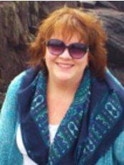 Homefarm Family Chiropractic - Dr. Maureen