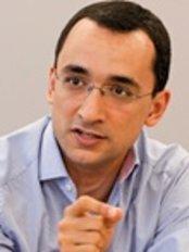 Dr. Karim Fawzys Dental Clinic - Dr Karim Fawzy, BDS, MSc, PhD, MFDS-RCSEd, Dr. med. dent.