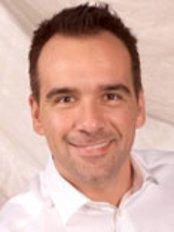 Dr Christos Sideris Dr Ezra Kleinman-Blainville - Dental Clinic in Canada