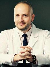 Dr. Alexandru I. Calu - Chirurgie Plastica si Estetica - Plastic Surgery Clinic in Romania