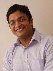 Chaudharis Dental Clinic - Dr Amit Chaudhari