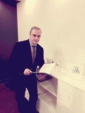 Dimitrios Laoulakos - Plastic Surgeon (Athena) - Plastic Surgery Clinic in Greece