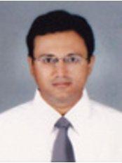 Rishi Multispeciality Dental Clinic - Dr Tejas Trivedi