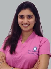 Monarch Dental Clinic - Vadodara - Dr. Aesha Patel