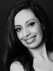 Elite Spine Clinic - Ms Gugan Hair BOst (Hons) GradIOSH Clinic Director