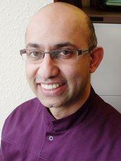 denta-care - Dr Asif Khota
