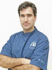 Clínica Dental Curie - Dental Clinic in Spain