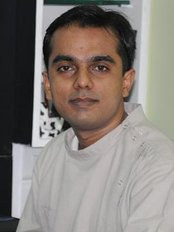 Ivories Dental Clinic & Dental Implant Clinic - DR ALAAP SHAH (BDS, MDS, MIPS) PROSTHODONTIST & IMPLANTOLOGIST