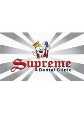 Supreme Dental Clinic - business card