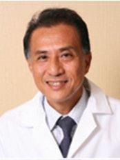 Pacific Dental Care - Dr. Surachart Nunbhakdi, Founder