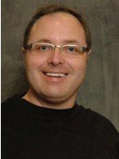 Dr. Robin J. Slowenko - Dental Clinic in Canada