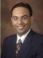 Smile With Confidence Dental Care Centre - Dr AMAR RAVJIANI,M.D.S.(MUM)