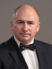 Prof J Kisis - Aesthetic Dermatologist - John Kisa