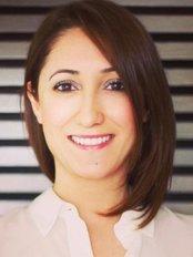 Dr. Q. Esra Arpacı - Dental Clinic in Turkey
