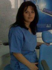 Dr. Mirela Dragomir - Dental Clinic in Romania