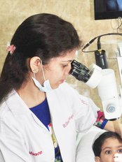 Make My Smile Multispecialty Dental Clinic - Treatment Being Done By Latest Machines Including Dental Operating Microscope