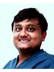 Navkar Dental Clinic - Dr.Ravin Shah