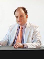 Dr. Juan Mora - Dr Juan Mora