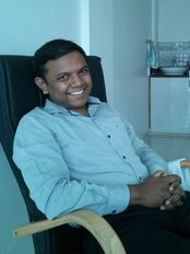 Urmi Dental Care Centre - Dr Vipul Parmar