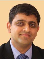 OraCare Dental Centre - Dr Aakash Shah - Founder & CEO at OraCare Dental Centre
