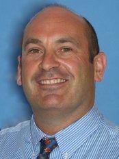 Dr Michael Blum - Dr. Michael Blum BSc BDS MOrth RCS (Ed)