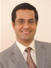 Signature Smiles Dental Clinic - Colaba - Dr Sandeep Khanna