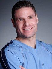 Roni Munk MD - Dermatology Clinic in Canada