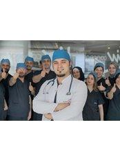 Elithairtransplant - Dr. Balwi with Team