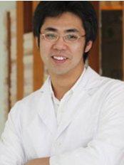 Patongsmile International Dental Clinic - Dr. Thanit