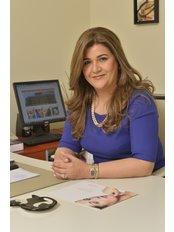 DermaOne Center - Dr. Nedhal Khalifa