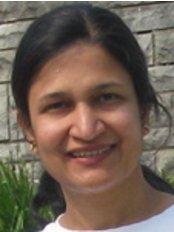Family Smiles - Uma Ramachandran