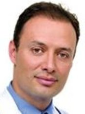 Dr. Mauricio Pineda - Bogotá - Plastic Surgery Clinic in Colombia