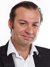 Dr. Eric Rondini-Gilli - Plastic Surgery Clinic in France
