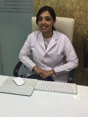 Dentium Dental Care - Dr.Shubhada Sharma Bharadwaj